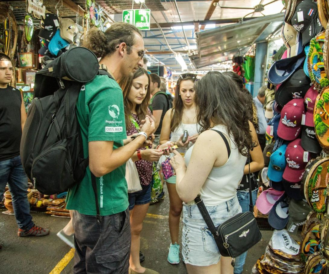 Gap year volunteer visits a market with other international volunteers in San Jose, Costa Rica.